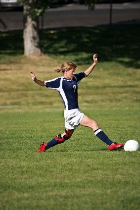 Soccer player wearing an ACL brace