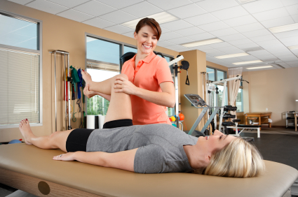 Physical therapist helping a woman recover from injury