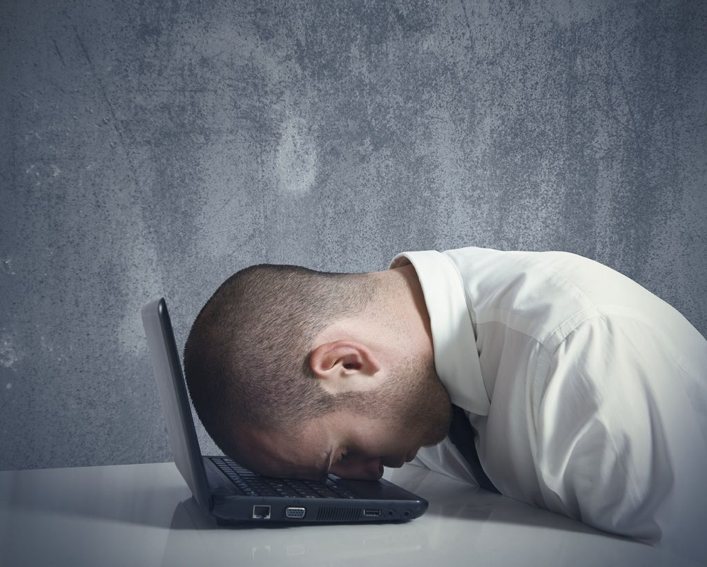 Doctor face down on laptop computer