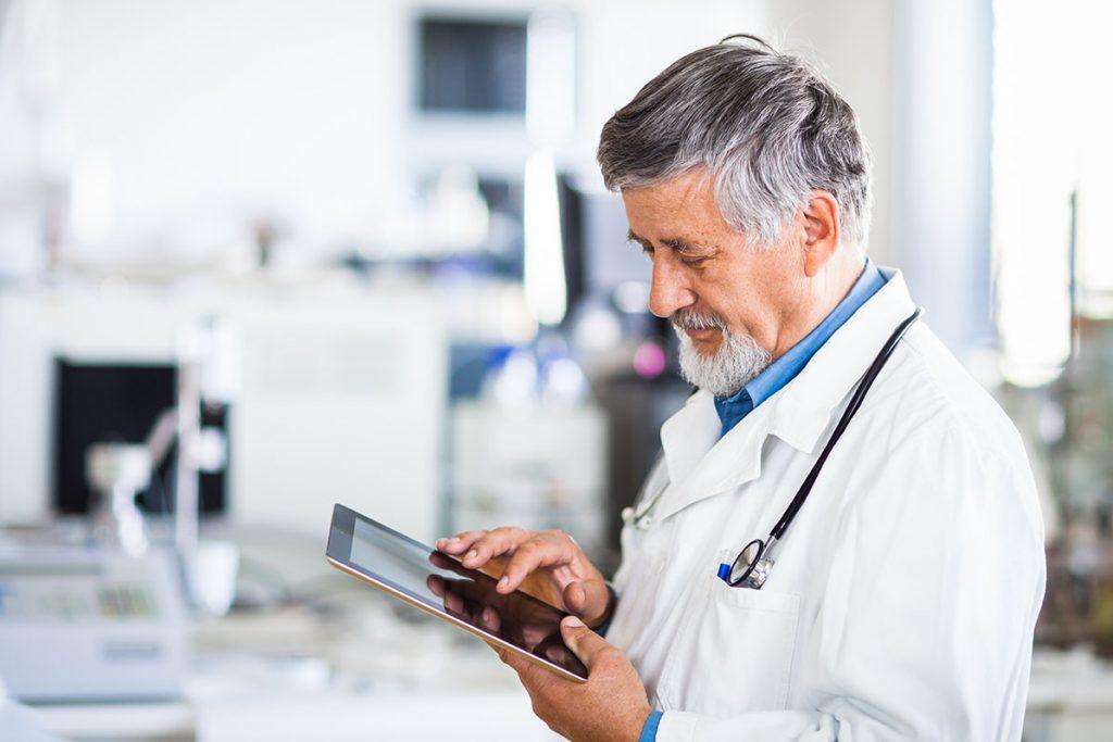 Doctor using iPad for social media