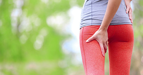 Female runner with hamstring injury