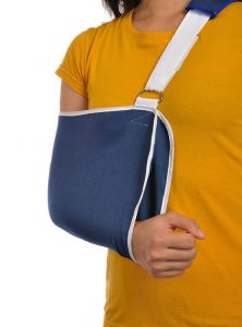Woman in arm sling after shoulder surgery