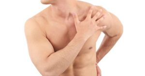 Man with shoulder injury in pain