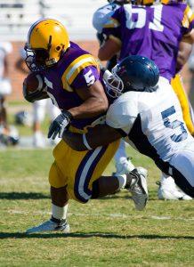 Football tackle, risking a burner or stinger