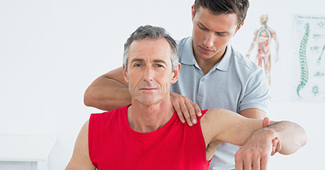 Man undergoing physical therapy on his shoulder
