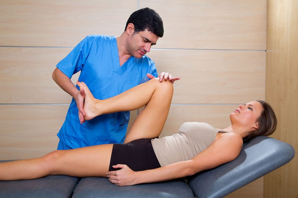 Physical therapist working on a hip flexor injury