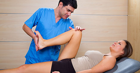 Physical therapist working on knee motion after injury
