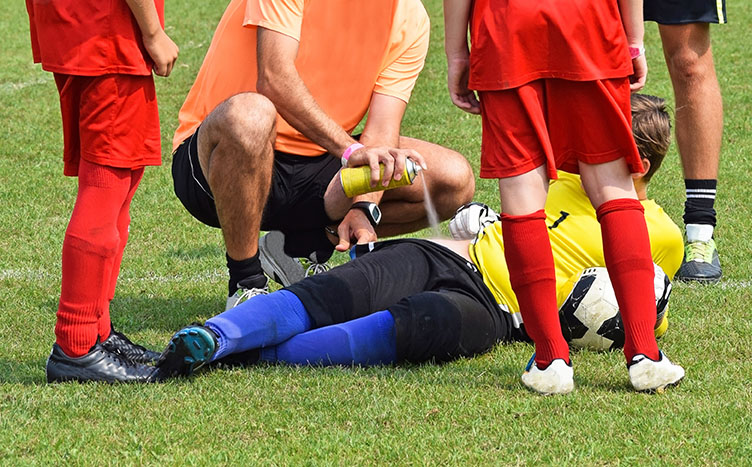 Athletic trainer treating a soccer injury