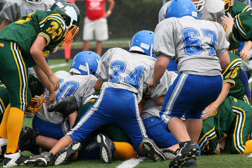 Should youth football involve tackling?