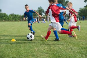 Boys playing in soccer game
