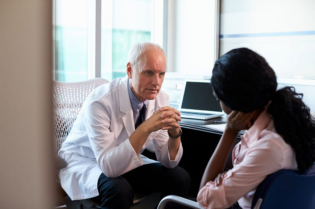 Doctor talking to a concerned patient