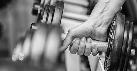 Lifting weights with dumbbells